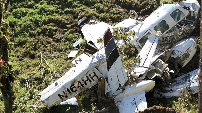 N164HH, a twin-engine Piper Smith Aerostar 600, dead on the side of a South American mountain range. Remnants of plane used in American Made starring Tom Cruise.